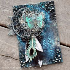 Have made a card where feathers is the theme.... In the background you see new stencil from 13arts . Chipboard and colors are also ...
