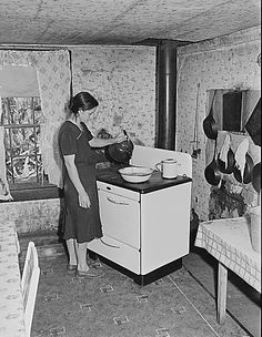 wife of miner, in the kitchen of their three room house which they rent for $6 monthly. Big Jim Coal Company, Bell County, Kentucky