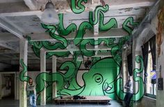 This anamorphic octopus mural looks like it's creeping up the walls of an entire room