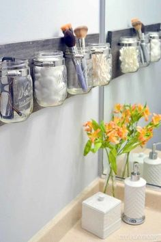 Mason jars attached to a wooden board make a farmhouse-chic bathroom storage option that keeps items off the vanity top. Perfect for holding cotton balls, Q-tips, makeup brushes, and toothbrushes and toothpaste, the jars attach to the board with hose clamps from the plumbing supply aisle. Get the tutorial at the DIY Playbook.