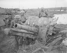 WWI, 9 Oct Men of the Battalion, Coldstream Guards, looking at a German howitzer (possibly cm Feldhaubitze they captured on the outskirts of Houlthulst Forest during the Battle of Poelcappelle. © IWM (Q Battle Of Passchendaele, World War I, Cannon, American History, Wwii, Mount Rushmore, Military, In This Moment, German