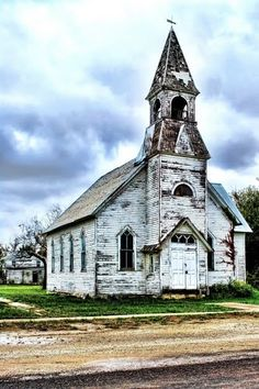 Abandoned Church, Lost Springs Kansas. I would love to purchase an old building like this, take down the steeple but keep the bell tower and make it a home. Perhaps someday I'll get the chance.