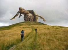Backpackers approaching a mysterious statue /// #travel #wanderlust
