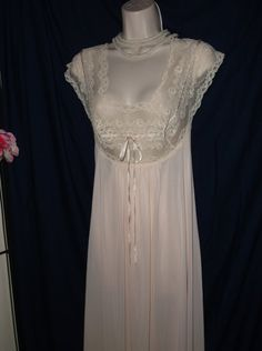 Fabulous Olga nightgown, vintage 1970s, rare Style No. 9659, size Medium. Soft, feminine pale pink body with sheer beige lace around neckline, bust and cap sleeves. The lace does not stretch but is lightly shaped and offers light support to flatter your bust. Near mint condition, with little to no signs of wear. Perfect as a bridal nightgown or for your special occasion. Measurements are:  Bust: 34 - 38 Waist: Free Hips: Free Total length: 55  Please feel free to ask me questions, and be…