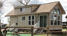 400 square feet with a full size bedroom, a small kitchen and living area.