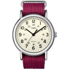 @Overstock - A cream dial hosts large easy-to-view numbers in this casual watch from Timex. A silvertone brass case and fuchsia nylon strap make for stylish and comfortable wear of this everyday watch.http://www.overstock.com/Jewelry-Watches/Timex-Womens-Weekender-Fushia-Slip-through-Strap-Watch/6095343/product.html?CID=214117 $30.50
