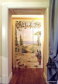 This painting, in addition to hiding a closet with three doors, deceives the viewer that the hallway drags on with a path that guides him to the sea horizon. www.scarmignan.com