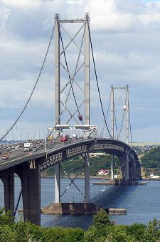 The Forth Road Bridge, Queensferry, Edinburgh constuction began in 1958. When it was opened in 1964 it was the longest suspension bridge in Europe and the fourth longest in the world.  The clearance for shipping below the centre of the bridge is 163 ft, and 150 ft near the towers.