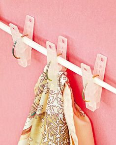 Clothes pin style clips on a rod.  Then maybe my kids can get them with out ruining the hangers or hurting the scarves!