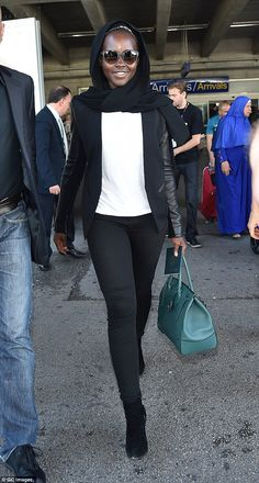 Travelling in style: Lupita Nyong'o was all smiles as she arrived in the South of France...
