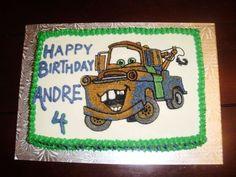 Full buttercream cake. Hand drawn Mater from Cars.