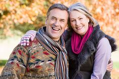 Photo about Affectionate senior couple on autumn walk with trees in background. Image of people, healthy, happy - 5305896