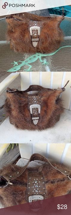 Faux fur western purse. Faux fur western purse, super cute in great condition! Measures width 14 inches and is 10 inches tall. Bags