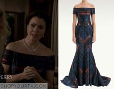 Mellie Grant (Bellamy Young) wears this blue and red off the shoulder in this week's episode of Scandal.  It is the J Mendel Off the Shoulder Lurez Jacquard Gown.