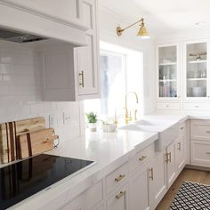 white + brass kitchen