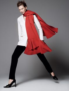 Karlie Kloss in a Christian Dior jacket, pants, and scarf