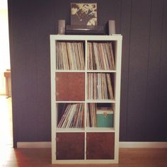 Materials: EXPEDIT Door Hacks Description: We added some nice raw wood doors to our EXPEDIT bookshelves which we stained to match our furn. Bookcase Door, Bookshelves, Ikea Hacks, Ikea Expedit, Ikea Ikea, Apartment Makeover, Apartment Ideas, Vinyl Storage, Cube Shelves