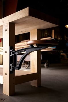 After over a year of development, we& excited to announce pricing and availability of our Swing Away Seat! But first a few word. Workbench Designs, Workbench Plans, Woodworking Workbench, Woodworking Workshop, Woodworking Furniture, Woodworking Shop, Garage Workbench, Folding Furniture, Metal Furniture