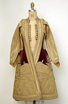Coat    Date:      19th century  Culture:      European, Eastern  Medium:      silk, metallic  Dimensions:      Length at CB: 40 1/2 in. (102.9 cm)  Credit Line:      Gift of Mr. Alan L. Wolfe, 1956  Accession Number:      C.I.56.6.3