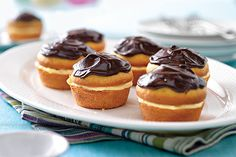 Small and mighty, these Boston cream pies are mini in size but have all the big, classic flavors: sweet cake, vanilla filling and a swirl of chocolate.