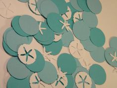 Beach Wedding Party Decoration - Die Cut Embellishment- Turquoise and white ocean sea creature Confetti - Sand Dollars and Starfish. $4.99, via Etsy.