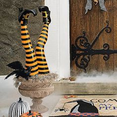 Look who dropped in to your wickedly wonderful Halloween display! Each vibrant orange-and-black striped resin leg is topped by a black boot with a curled toe and a golden buckle. Pose them together, however you like, in the garden, beside your front door or in an urn in the entryway they're made to live indoors and out. Whether in your yard or in an urn, this pair of staked witch's legs is sure to declare there's no place like home Crafted from durable...