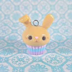 Hoppy Easter! This bunny cupcake is inspired by @kimby_kat I love this charm, it even has a little tail on the back. Hop-fully () everyone had a nice Sunday-I got lots of chocolate! #kawaii #cute #polymerclay #polymerclaycharms #crafts #spring
