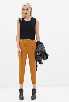 Honestly, the material is not my fave but the color is exceptional and this cropped, pleated look kept it's space on the runways for Fall 2015. These pants are $19.80 and will look great with high, slouchy knit socks and boots, bare ankles and heels or the most amazing chancy menswear shoes you can finagle.  Pleated Woven Trousers | FOREVER21 - 2000058785