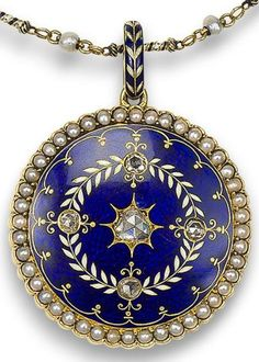 A gold, enamel and diamond locket/necklace, by Carlo Giuliano, circa 1880.     The circular locket with blue and white guilloché enamel and rose-cut diamond highlights within a border of half pearls, the reverse with a black enamelled monogram, to a similarly-enamelled bail, and delicate blue and white enamelled ropetwist necklace interspersed with grey seed pearls, clasp with maker's mark CG, chain length 36.9cm, locket length 4.9cm. Via Bonhams.