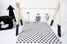 Dipped Wooden Baby Activity Play Gym Hanging Bar (Charcoal black colour shown) by AugustLaceDesigns on Etsy https://www.etsy.com/listing/288087035/dipped-wooden-baby-activity-play-gym
