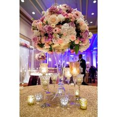 Amazing floral centerpiece at this blue uplighting event! Great pic via #bellethemagazine