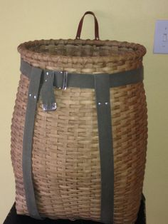 This is a beautiful hand woven pack basket. Sturdy enough to use for your next hike or beach trip. Also great as a beautiful decoration for