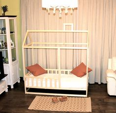 Toddler bed house is wooden bed for your children play and sleep. Bed is designed following Montessori toy principles of independence. The most unexpected benefit of a floor bed is childs freedom of movement. Wooden house bed is made from aspen. Aspen is very strong and moisture