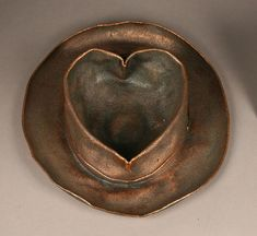 walt disney turned his hat into bronze after shaping it's top into a heart for his wife..now the hat is in the walt disney family museum san francisco