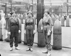 MUNITIONS FACTORIES UNITED KINGDOM DURING FIRST WORLD WAR (HU 96426) Three female munitions workers stand in front of 15-inch high explosive shells at the National Shell Filling Factory at Chilwell, Nottinghamshire, during the First World War.