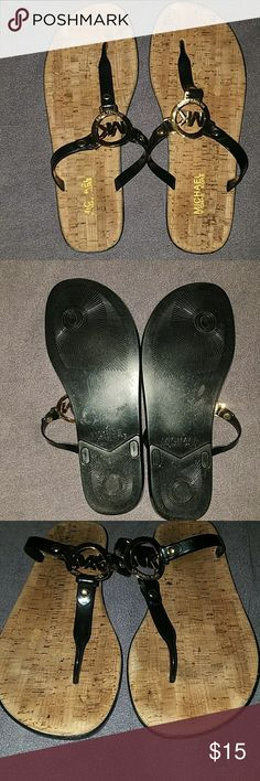 Used Michael Kors Charm Jelly Corkbed Sandals MICHAEL Michael Kors Charm Jelly Sandals T-Strap Jelly Sandals with comfy cork footbed. Size: 10  There is a little bit of wear on the cork footbed. Worn a few times for work. Still a lot of life in them!  *When these sandals are on your feet, you can Not see the wear.* Michael Kors Shoes Sandals