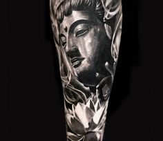 Buddha tattoo by Michael Taguet