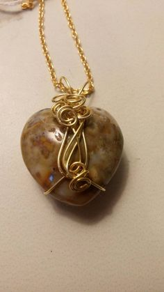 Check out this item in my Etsy shop https://www.etsy.com/listing/232740993/wire-wrapped-pendant-gold-filled-healing