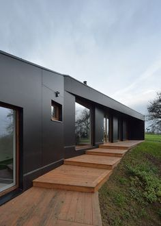 Built by 3+1 architekti in Bořislav, Czech Republic with date 2014. Images by Pavel Plánička. Lack of space and tight layout of the existing house led builder to the decision to add an extension. The west side o...