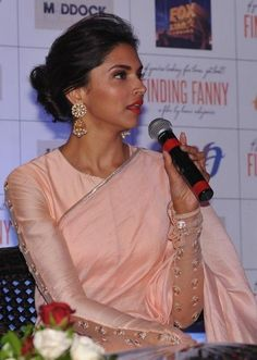 "Deepika Padukone in Pink Saree with Full Sleeve Blouse and Round Neck Designs New Images 2014 Elegant and exotic Bollywood Actress Deepika Padukone in Pink Saree at the promotional event of film ""Finding Fanny"". In the year Fanny Movie was th Blouse Back Neck Designs, Sari Blouse Designs, Saree Blouse Patterns, Blouse Styles, Sari Bluse, Peach Saree, Stylish Blouse Design, Freida Pinto, Vestidos"