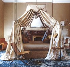 """From """"The World of Muriel Brandolini: Interiors"""" -- floating bed and celestial rug bedroom"""