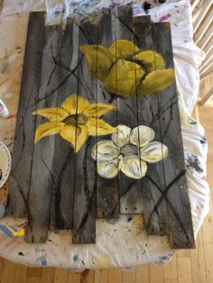 Painted flowers on pallet board by Mason.