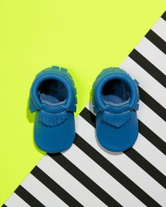 The brilliant cobalt blue Malibu moccasin is made of 100% genuine leather and sea breezes. | Soft Sole Baby Shoes, Neon Graphic Kid Style.  http://freshlypicked.com/collections/moccasins
