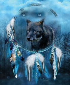 A moon so bright with magic and blue light brings mystery and this spirit of midnight.  Midnight Spirit prose by Carol Cavalaris  This artwork of a black wolf with blue eyes, and blue wolf eyes in the background, all within a dream catcher, is from the 'Dream Catcher' collection by Carol Cavalaris.