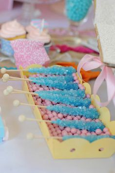 frilly ribbon whimsical first birthday party pink blue yellow sparkling light blue rock candy