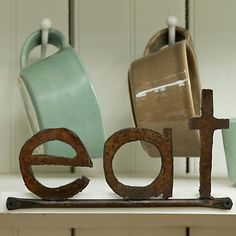"""As described on the Terrain website: """"Handmade from retired farm equipment in rural Pennsylvania, this rusted metal sign adds a bit of charm to your breakfast nook."""""""
