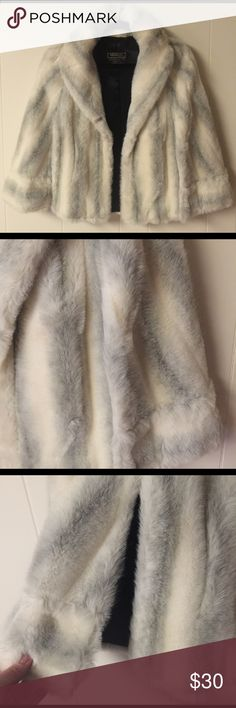 Tissavel White Gray Mink Cape Excellent condition for vintage white & gray fur cape / capelet in OS. This is tissavel faux fur which is the highest faux fur quality you can buy. Clean by furrier. Fully lined in black satin. No sleeves this just wraps and drapes over your shoulders and has 2 slits for your arms with 2 front pockets. Perfect for weddings or prom. Tissavel styled by LEPSHIRE Jackets & Coats Capes