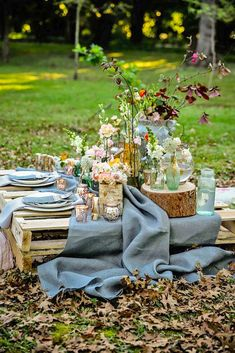 A pretty pallet picnic table using grey hessian burlap runner, filled with rustic decor elements, mercury votives, wood slabs and peach blooms in mix and match vases. Rustic Garden Picnic Wedding // N (Mix Wood Grey) Decoration Evenementielle, Picnic Decorations, Wedding Decorations, Pallet Wedding, Wedding Table, Rustic Wedding, Wedding Picnic, Picnic Weddings, Wedding Ideas