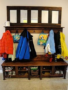 Mudroom - likes: the mirror at the top with a narrow shelf, cubbies at the bottom, but large enough for S's boots.