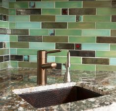 """Clay Squared to Infnity handmade field tiles are 2""""x8"""" glazed in Avocado, Wasabi, Copper Patina, Jade Moss, Hematite and Pesto with Cosmic Cloud accents randomly dispersed through out the backsplash."""